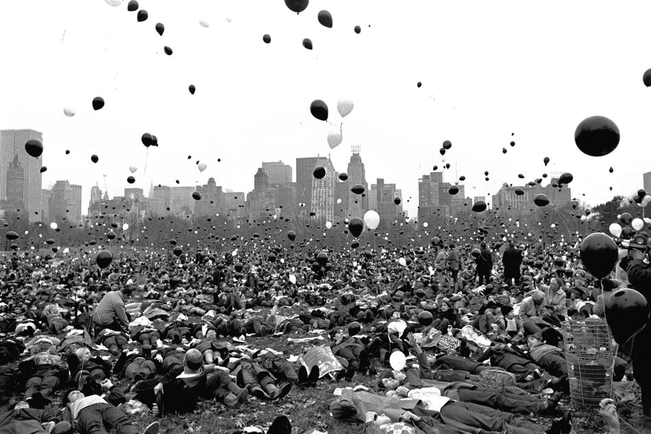 Supporters of the vietnam moratorium lie in the sheep meadow of new yorks central park nov 14 1969 as hundreds of black and white balloons float skyward